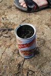 Tea brewed in an old tin in a tea garden Yi Wu