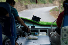 Bus driver filling his cup of tea in the mountains of Yunnan