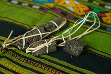 Forme de thé puerh <span class='translation'>(Pu Er tea)</span> produit au Laos