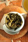 Leaves of young puerh <span class='translation'>(Pu Er tea)</span> infused Copyright Sébastien Vacuithé