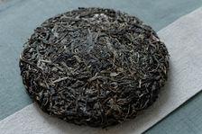Thé puerh <span class='translation'>(Pu Er tea)</span> compressé en galette