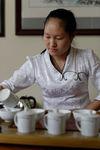 Vendeuse et producteur de thé (Kucong Shan Zhai) à Pu Er
