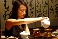 Young woman inusant a cup of puerh