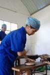 Compression artisanale d une galette de puerh <span class='translation'>(Pu Er tea)</span> (atelier Baopuxuan, YiWu)