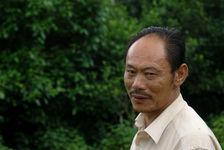 Zhai Guo Ting dans son jardin écologique de Mingfeng