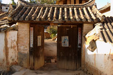 Portal protected by the effigy of Shen Menn in a village in Lincang, Yunnan